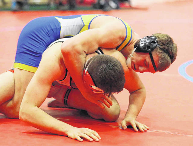 Chase Martin, top, of Delphos St John's competes against Sandy Valley's Matt Gentry during Saturday's Division lll state wrestling championships at Marion Harding.