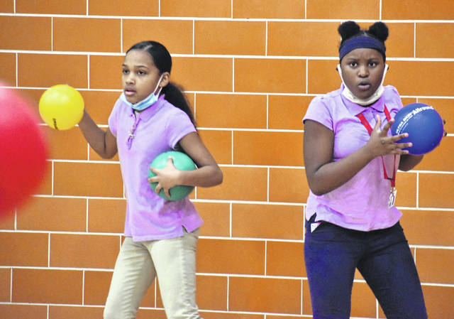 Strategy played a big role in the battle between North Middle School students and teachers Friday as they raised money for the American Heart Society by playing dodgeball.