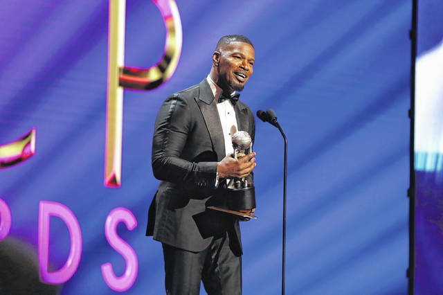 """Jamie Foxx accepts Outstanding Supporting Actor in a Motion Picture for """"Just Mercy"""" onstage Feb. 22, 2020, during the 51st NAACP Image Awards, Presented by BET, at Pasadena Civic Auditorium in Pasadena, California. (Leon Bennett/Getty Images for BET/TNS)"""