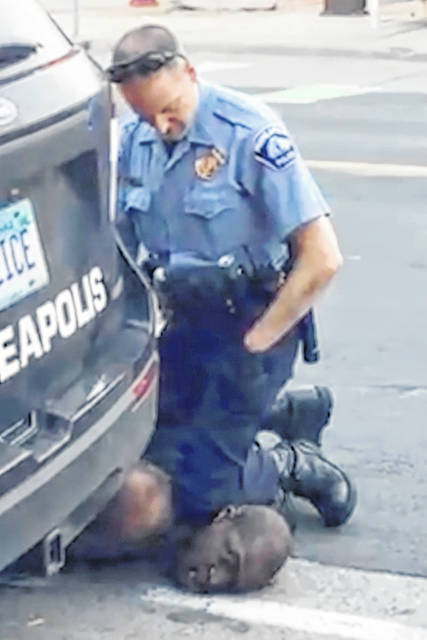 In this image from video provided by Darnella Frazier, Minneapolis Police Officer Derek Chauvin kneels on the neck of George Floyd in Minneapolis on Monday, May 25, 2020. The former Minneapolis police officer is charged with killing Floyd and went on trial Monday.