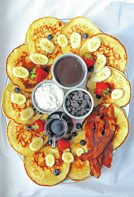 A pancake charcuterie, as prepared by St. Louis Post-Dispatch food writer Daniel Neman, shows the possibilities for using pancakes and assorted toppings.