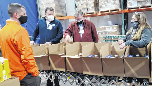 House Speaker Bob Cupp, middle, talks about food scarcity with, from left, Wayne Steed, director of business affairs for West Ohio Food Bank; state Rep. Jon Cross, R-Kenton; and Lisa Hamler-Fugitt, executive director of Ohio Association of Food Banks.