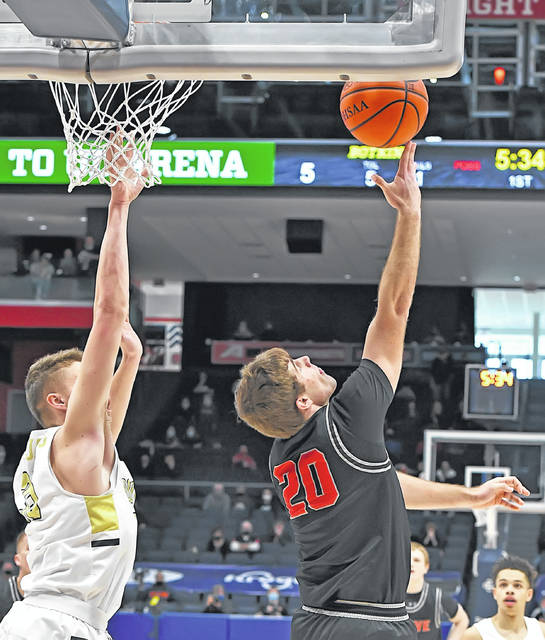 Columbus Grove's Ethan Halker goes for the reverse layup against Botkins' Jacob Pleiman during Sunday's Division IV State Championship at UD Arena in Dayton.