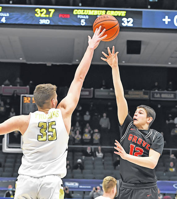 Columbus Grove's Trey Sautter goes high to get one past Botkins' Jacob Pleiman during Sunday's Division IV State Championship at UD Arena in Dayton.