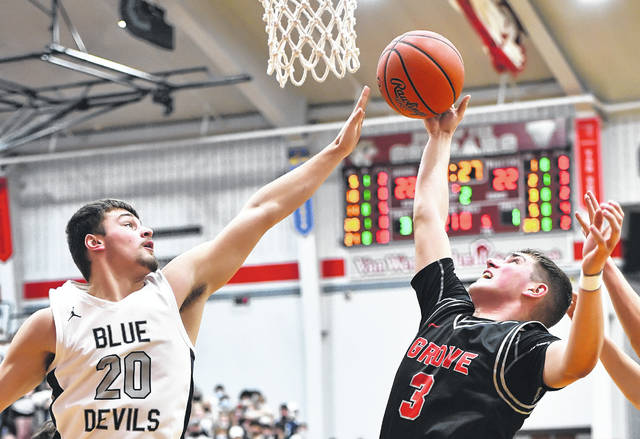 Columbus Grove's Tayt Birnesser puts up a shot against Carey's Landen Kemerley during a Tuesday night Division IV regional semifinal at Van Wert. See more regional photos at LimaScores.com.