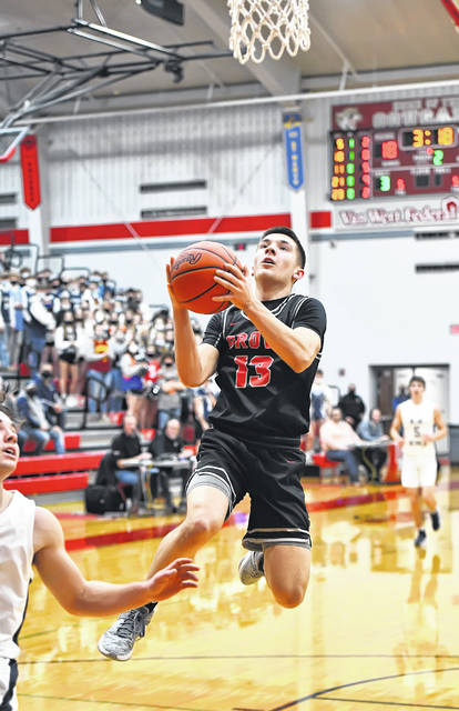 Columbus Grove's Jackson Schroeder goes up for a shot against Carey during a Tuesday night Division IV regional semifinal against Carey at Van Wert.