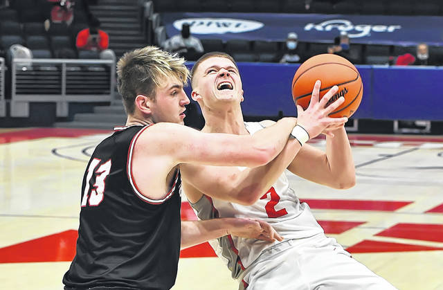 Columbus Grove's Blake Reynolds goes up for a shot against New Boston Glenwood's Kyle Sexton during a Friday Division IV state semifinal game at the University of Dayton Arena. See more state semifinal photos at LimaScores.com.