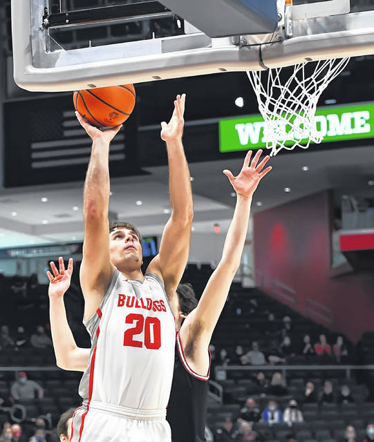 Columbus Grove's Ethan Halker puts up a shot against New Boston Glenwood's Chase Clark during a Friday Division IV state semifinal game at the University of Dayton Arena.
