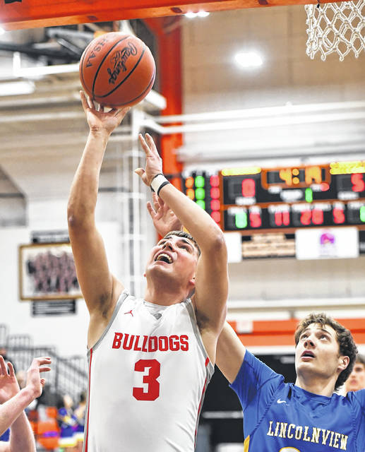 Columbus Grove's Tayt Birnesser puts up a shot against Lincolnview's Jake Bowersock during a Tuesday night Division IV district semifinal at the Elida Fieldhouse.
