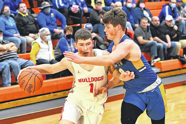 Columbus Grove's Bo Birnesser drives against Lincolnview's Creed Jessee during a Tuesday night Division IV district semifinal at the Elida Fieldhouse. Head to LimaScores.com to see more district photos.