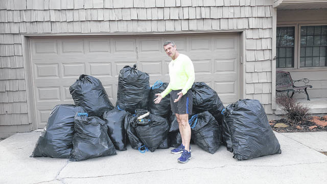 Dr. Darryl Haycock collected seven 55-gallon bags and 15 33-gallon bags of trash along a three-mile route in Shawnee Township recently.