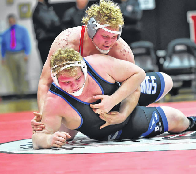 Columbus Grove's Jeff Meyer, top, wrestles Allen East's Eli Criblez during Sunday's Division III 84th Annual State Wrestling Tournament at Marion Harding High School.  Richard Parrish | The Lima News