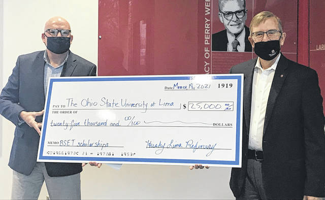 Husky Lima Refinery on Thursday donated $25,000 in scholarships to The Ohio State University-Lima in support of the school's new engineering technology major. Pictured from left are Jon Horn, senior HR manager for Husky Lima Refinery, and Ohio State University-Lima Dean Dr. Tim Rehner.