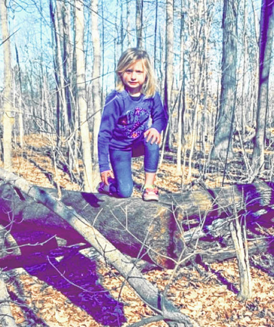 Being out on the trail, Mama discovered the beauty in both her daughters' personalities as they explored through the trees. Courtesy of Sarah Shrader