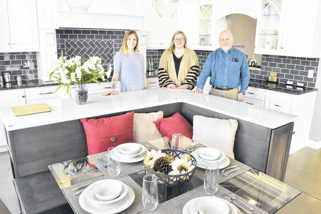 Claire Meyer, Abbey Burgei and Matt Hibbard are eager to assist customers at the Lima showroom of KSI Kitchen and Bath at 3035 Elida Road, Lima.
