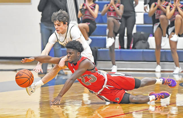 Lima Senior's Jourdyn Rawlins, front, goes to the floor for a loose ball against Perrysburg's Joe Bohman during a Thursday night Division I district semifinal at Lake High School in Millbury. See more district photos at LimaScores.com.