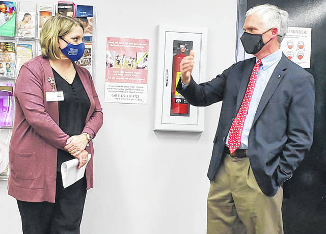 U.S. Rep. Bob Latta, right, R-Bowling Green, talks about COVID-19 vaccinations with Kim Rieman, health commissioner for Putnam County.