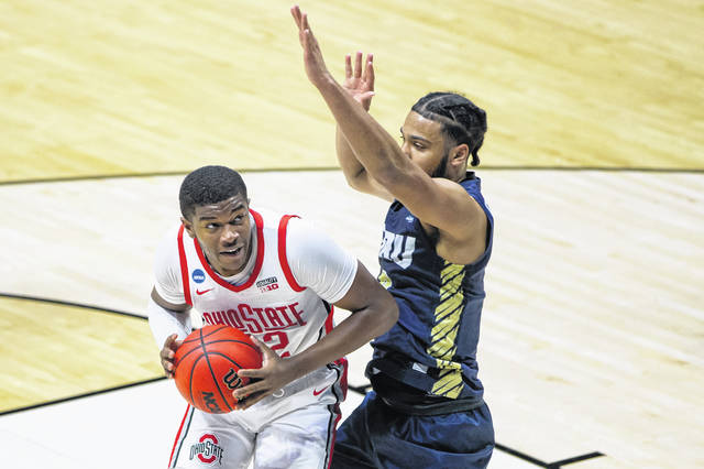 Ohio State's E.J. Liddell, left, gets pressure from Oral Roberts' Kevin Obanor during the Buckeyes' first-round loss in the NCAA men's basketball tournament last Friday.