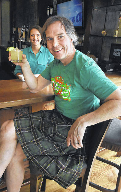 Wearing a kilt, Rob Nelson, owner of The Met in downtown Lima, shows off a concoction he made in March 2020. The Met will offer a Saturday brunch corn beef hash, Belgian waffles, Bloody Marys and Irish Coffee to help celebrate St. Patrick's Day.