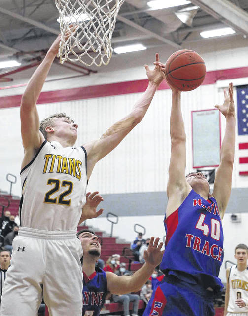 Ottawa-Glandorf's Colin White (22) and Wayne Trace's Kyle Stoller go for a rebound during Saturday's Division lll district final at Lima Senior.