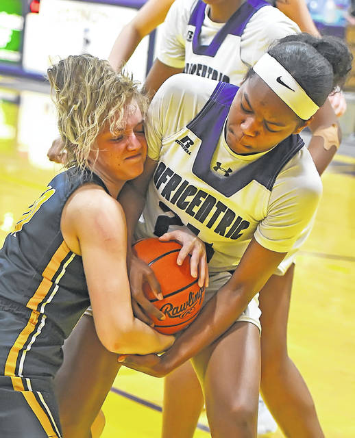Ottawa-Glandorf's Anna Siefker, left, and Africentric's Kamryn Grant compete for the ball during Saturday night's Division III regional final at Lexington. See more regional photos at LimaScores.com.