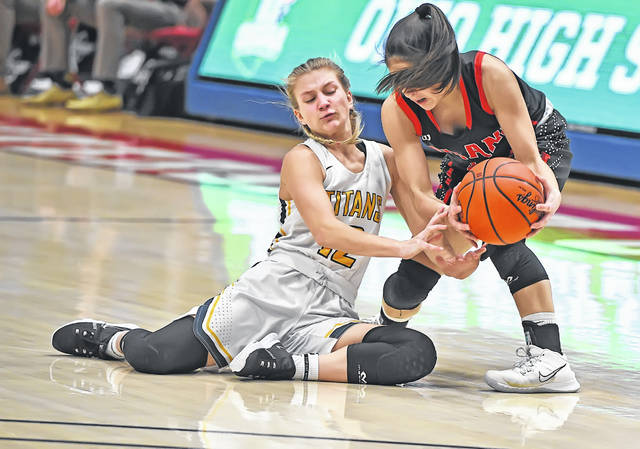 Ottawa-Glandorf's Lily Haselman, left, attempts to make a steal against Hiland's Ashley Mullet during Saturday's Division III state championship game at the University of Dayton Arena.