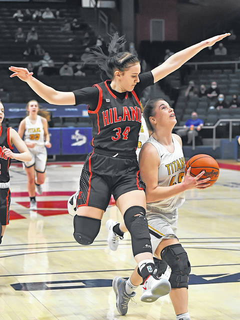 Ottawa-Glandorf's Chloee Glenn eyes the basket against Berlin Hiland's Kelsey Swihart during Saturday's Division III state championship game at the University of Dayton Arena.