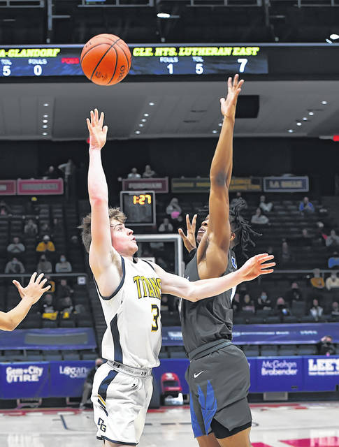 Ottawa-Glandorf's Brennen Blevins puts up a shot against Lutheran East's Sirr Hughes during a Friday Division III state semifinal at the University of Dayton Arena.