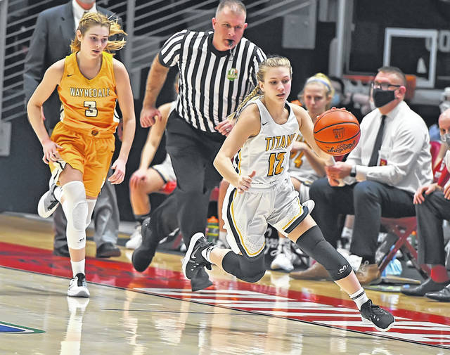 Ottawa-Glandorf's Lily Haselman drives ahead of Waynedale's Kelsey Wolfe during a Thursday Division III state semifinal at the University of Dayton Arena.