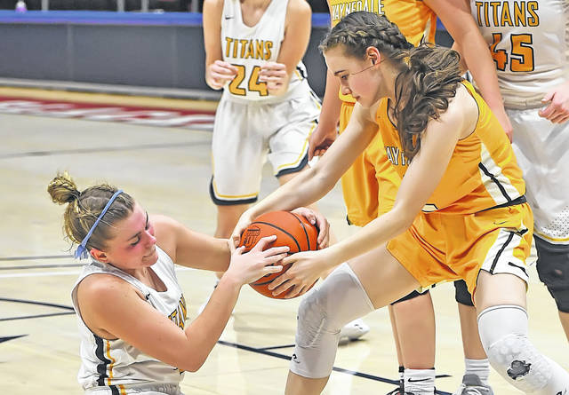 Ottawa-Glandorf's Kelsey Erford, left, and Waynedale's Alyssa Geiser compete for a loose ball during a Thursday Division III state semifinal at the University of Dayton Arena. See more state semfinal photos at LimaScores.com. Richard Parrish | The Lima News