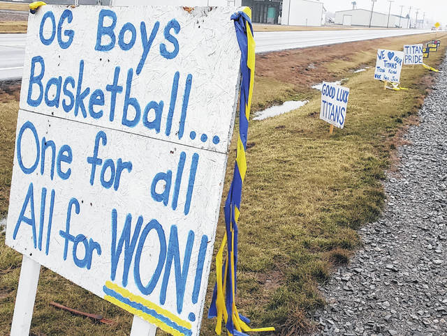 A series of signs along state Route 65 south of Ottawa show support for the Ottawa-Glandorf boys basketball team. The signs were located near Ottawa Self Storage.