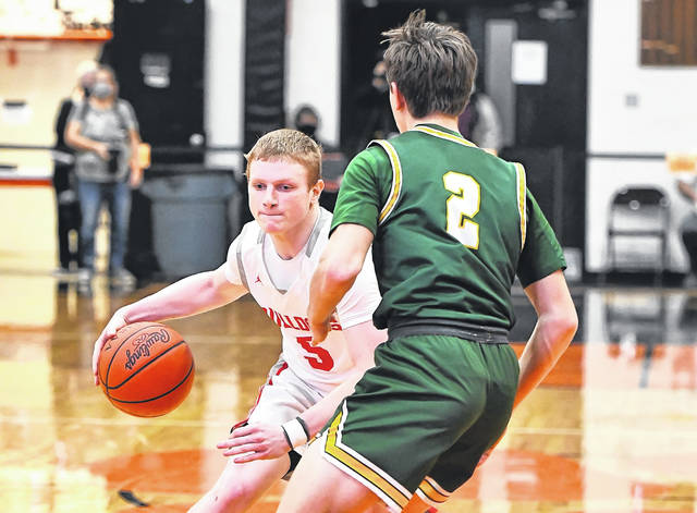 Columbus Grove's Gabe Clement, here being guarded by Ottoville's William Miller during the Division IV district final at the Elida Fieldhouse earlier this month, is averaging 10.7 points a game.
