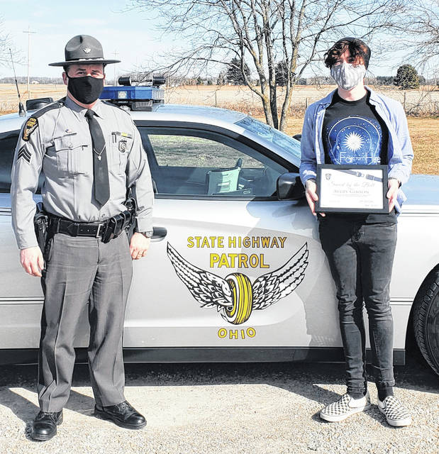 Avery Gibson (right) is the latest person to join the Saved by the Belt Club. He is pictured here with Ohio State Highway Patrol Lieutenant Tim Grigsby.