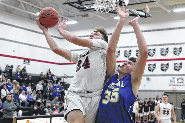 Shawnee's Caden Vermillion goes up for a shot against St. Marys' Austin Parks during Saturday night's Division II district final at Spencerville. See more district photos at LimaScores.com.