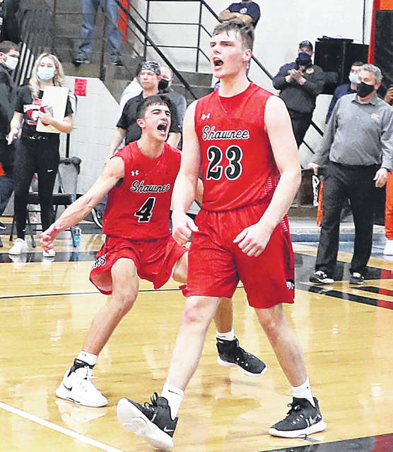 Shawnee's Brady Wheeler (4) and George Mangas (23) celebrate after defeating Akron Buchtel 88-74 in Saturday's Division II regional final to earn a state final four berth. Mangas is averaging 31.7 points, 5.5 rebounds and 2.4 steals a game while Wheeler is averaging 9.4 points, five assists and 1.5 steals entering Saturday's state semifinal against Akron St. Vincent-St. Marys.