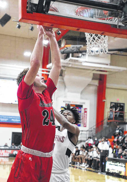 Shawnee's Caden Vermillion, who is averaging 6.3 rebounds and 3.7 assists per game, puts up a shot against Akron Buchtel's Cordell Livingston during Saturday Division II regional final at the Elida Fieldhouse.
