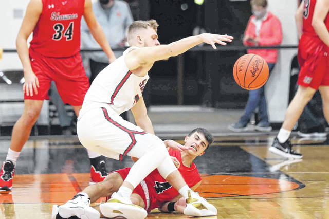 Shawnee's Brady Wheeler, bottom, collides with Shelby's TJ Pugh while attempting to make a steal during a Thursday night Division II regional semifinal at Elida. See more regional photos at LimaScores.com.