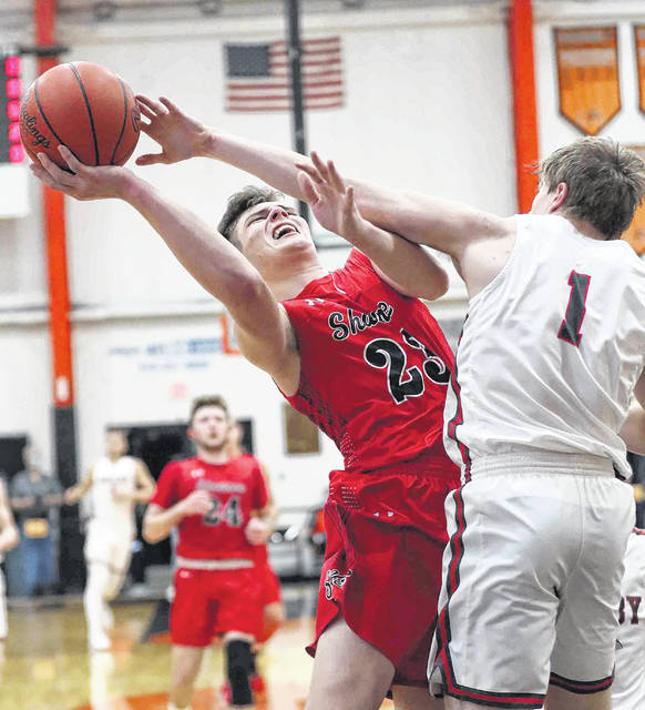 Shawnee's George Mangas puts up a shot against Shelby's Brazure Roberts during a Thursday night Division II regional semifinal at Elida.