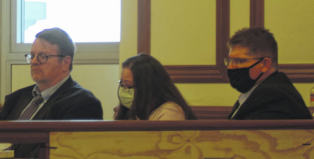 Vicki Shellabarger sits with her defense team on the first day of witness testimony.