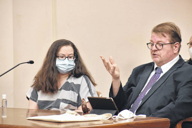 Vicki Shellabarger, pictured with defense attorney Steve Chamberlain, appeared in court briefly on Wednesday as attorneys wrangled over last-minute motions prior to the start of the trial next week.
