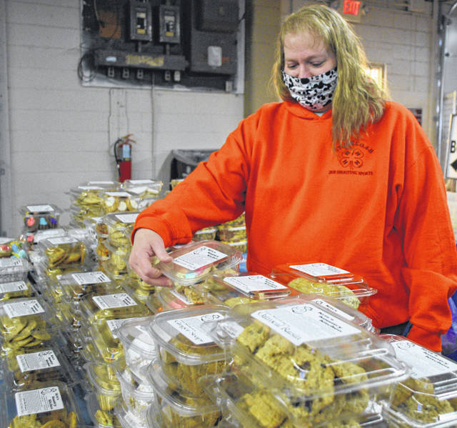 Kris Kempf, with Kris's Kountry Kitchen, checks out her inventory at the Shipshewana on the Road event Sunday at the Allen County Fairgrounds.