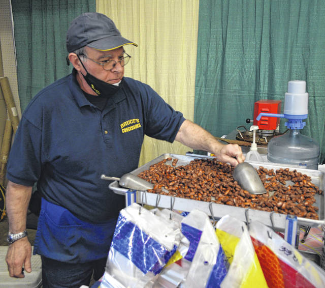 Jeff Bruce, with Bruce's Concessions, stirs up cinnamon sugar-coated almonds at the Shipshewana on the Road event Sunday at the Allen County Fairgrounds.