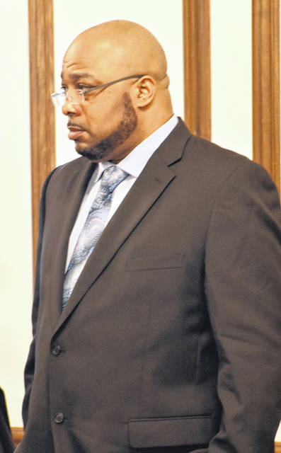 Terrez Carter stands as the jury enters the room in his trial in Allen County Common Pleas Court on Wednesday. Jurors heard from one of two women who claim they were raped by Carter.