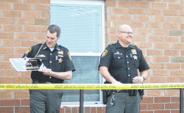 Allen County Sheriff Matthew Treglia, left, stands with D.A.R.E. officer Deputy Ted Falke at the grand reopening of the department's D.A.R.E. building.