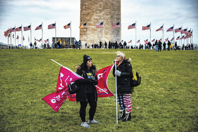 Supporters of President Donald Trump gather on the lawn around the base of the Washington Monument on the National Mall on Jan. 6 in Washington, D.C. Church pastors said they try to counter conspiracy theories, such as the ones offered by QAnon, but find it difficult to change minds or hearts.