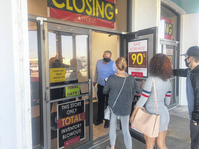 The doors of Macy's are opened one last time Sunday morning at the Lima Mall.