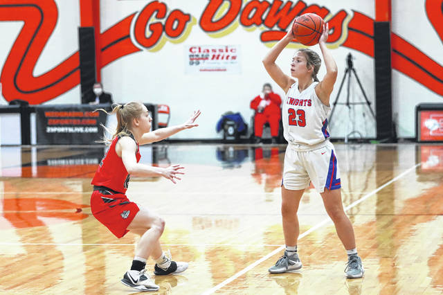 Columbus Grove's Sage Clement guards Crestview's Olivia Cunningham (23) during Saturday night's Division IV regional final at Elida. See more regional photos at LimaScores.com.