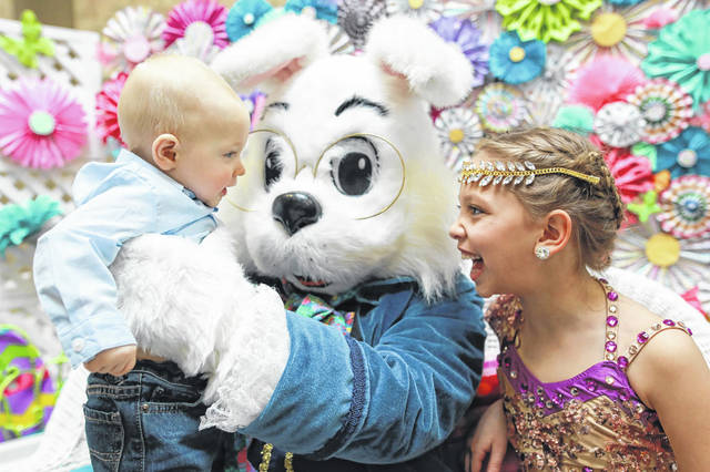 Jayce Bellman, 8 months old, and Leah Escamilla, 9, of Ottawa, met the Easter Bunny at the Lima Mall back in 2019. The big-eared wonder will return to the Lima Mall starting Thursday.