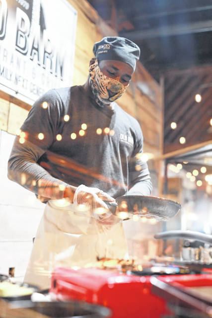 Donnell Brown makes breakfast at the omelet station at Old Barn Restaurant & Grill.