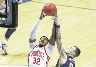 Ohio State's E.J. Liddell (32) grabs a rebound against Oral Roberts' Carlos Jürgens during a Friday NCAA Tournament first round game at Mackey Arena in West Lafayette, Ind.